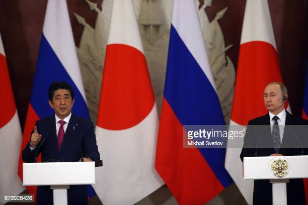 Russian President Vladimir Putin and Japanese Prime Minister Shinzo Abe are seen during their talks at the Grand Kremlin Palace on April 27 2017 in...