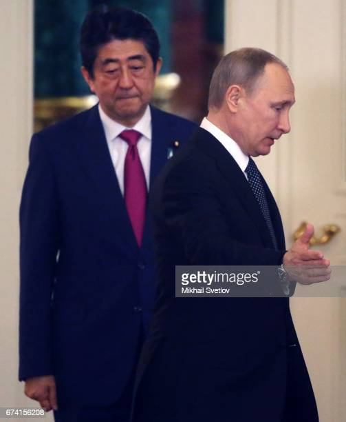 Russian President Vladimir Putin and Japanese Prime Minister Shinzo Abe enter the hall at the Grand Kremlin Palace in Moscow Russia April 2017 Shinzo...