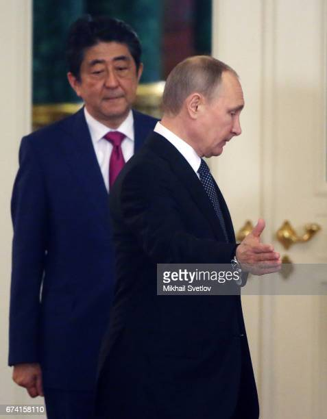 Russian President Vladimir Putin and Japanese Prime Minister Shinzo Abe enter the hall during their talks at the Grand Kremlin Palace in Moscow...