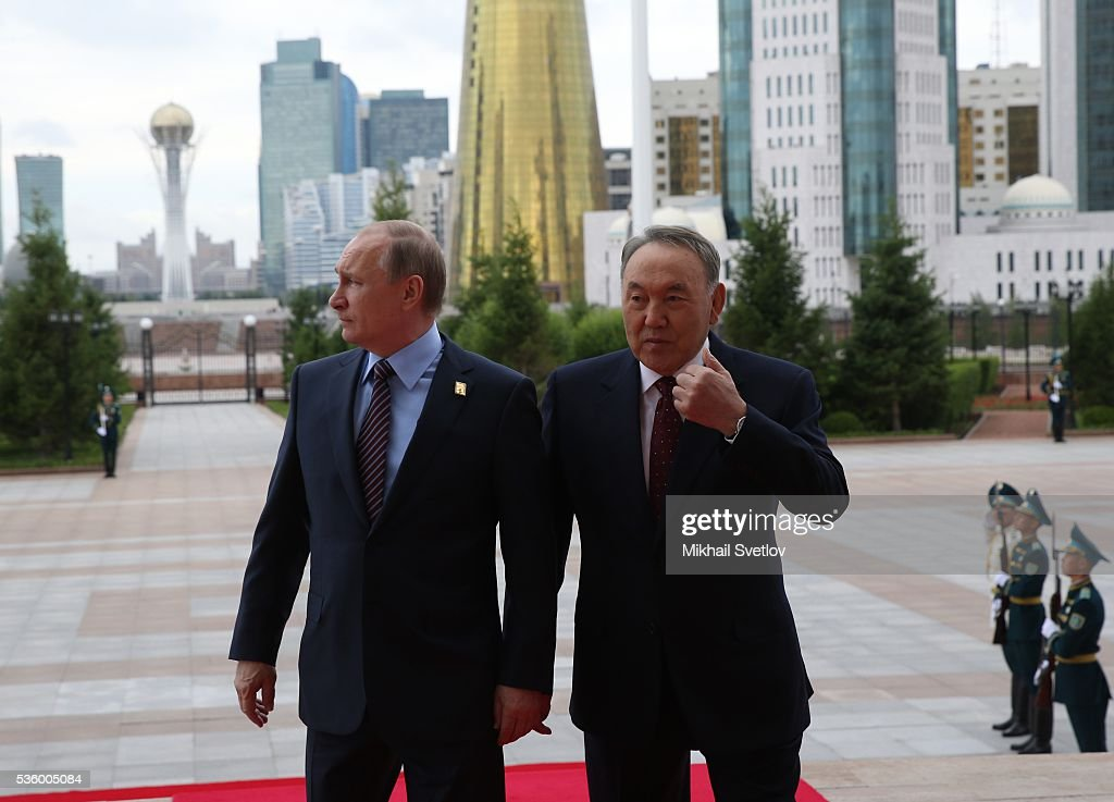 ASTANA, KAZAKHSTAN - MAY, 31 (RUSSIA OUT) Russian President <a gi-track='captionPersonalityLinkClicked' href=/galleries/search?phrase=Vladimir+Putin&family=editorial&specificpeople=154896 ng-click='$event.stopPropagation()'>Vladimir Putin</a> (L) and Kazakh President <a gi-track='captionPersonalityLinkClicked' href=/galleries/search?phrase=Nursultan+Nazarbayev&family=editorial&specificpeople=4556028 ng-click='$event.stopPropagation()'>Nursultan Nazarbayev</a> (R) arrive to the Eurasian Economic Union Summit at Akorda Palace on May 31, 2016 in Astana, Kazakhstan. Heads of the Eurasian Economic Union (EAEU) member states Russia, Belarus, Armenia, Kazakhstan and Kyrgyzstan have gathered in Astana for the summit. President Putin will also hold talks with Kazakh President <a gi-track='captionPersonalityLinkClicked' href=/galleries/search?phrase=Nursultan+Nazarbayev&family=editorial&specificpeople=4556028 ng-click='$event.stopPropagation()'>Nursultan Nazarbayev</a>.