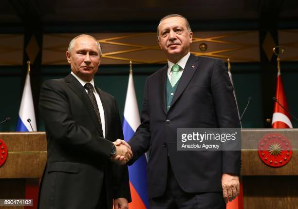 Russian President Vladimir Putin and President of Turkey Recep Tayyip Erdogan shake hands during a press conference after their meeting at...