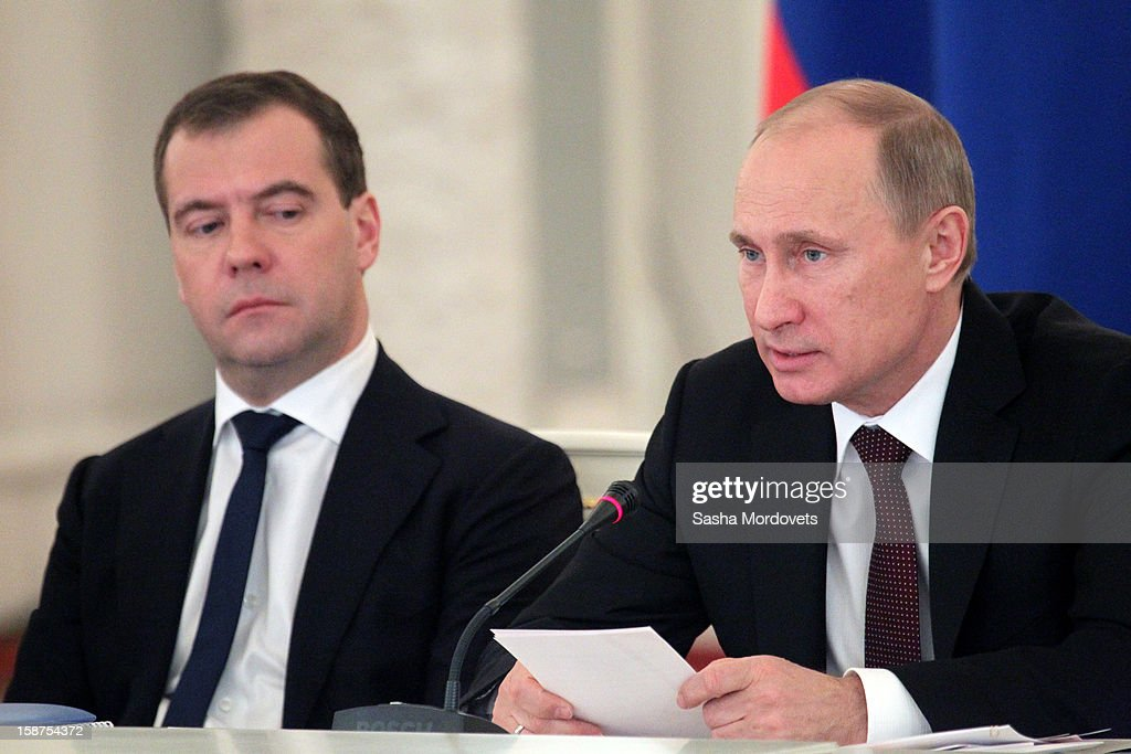 Russian President Vladimir Putin (R) and Prime Minister Dmitry Medvedev (L) attend a State Council meeting at Grand Kremlin Palace on December 27, 2012 in Moscow, Russia. During the meeting Russian President Vladimir Putin said that he will sign a bill that will ban Americans from adopting Russian children.