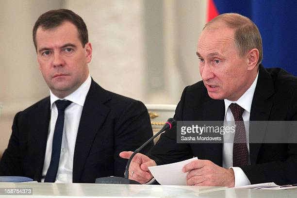 Russian President Vladimir Putin and Prime Minister Dmitry Medvedev attend a State Council meeting at Grand Kremlin Palace on December 27 2012 in...