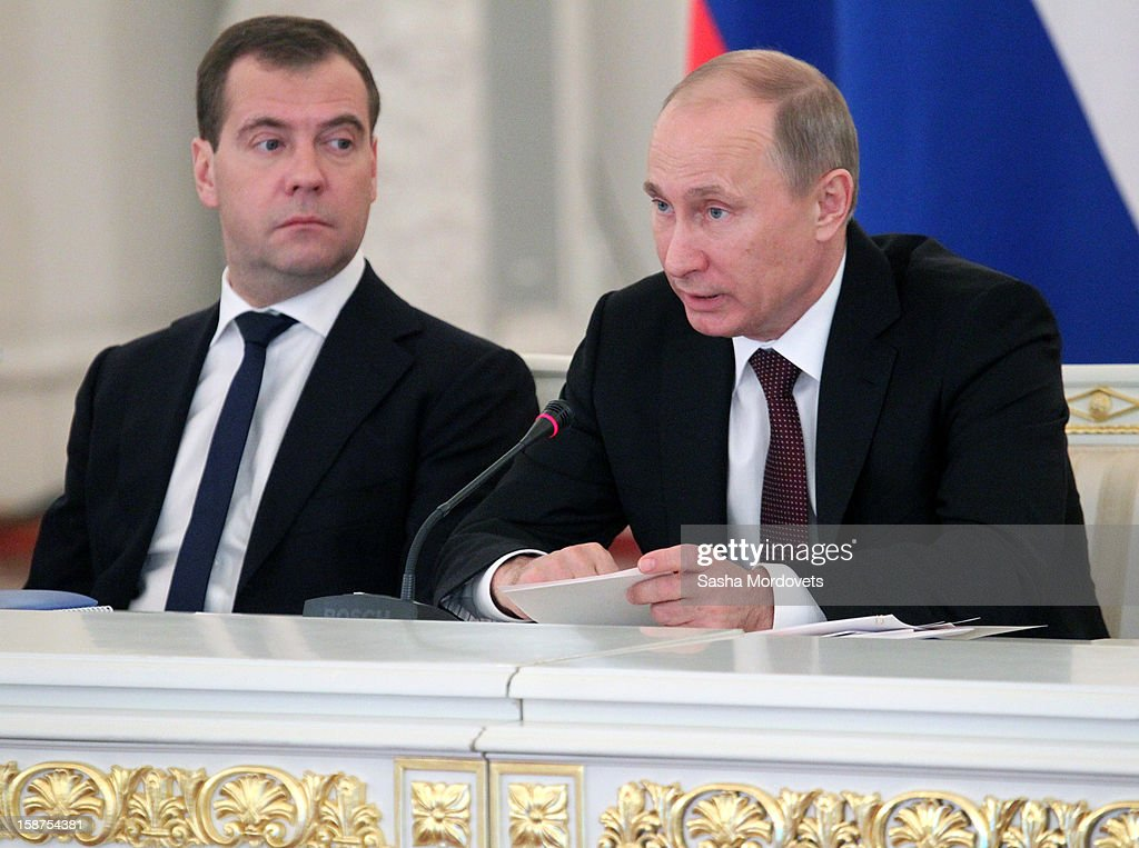 Russian President <a gi-track='captionPersonalityLinkClicked' href=/galleries/search?phrase=Vladimir+Putin&family=editorial&specificpeople=154896 ng-click='$event.stopPropagation()'>Vladimir Putin</a> (R) and Prime Minister <a gi-track='captionPersonalityLinkClicked' href=/galleries/search?phrase=Dmitry+Medvedev&family=editorial&specificpeople=554704 ng-click='$event.stopPropagation()'>Dmitry Medvedev</a> (L) attend a State Council meeting at Grand Kremlin Palace on December 27, 2012 in Moscow, Russia. During the meeting Russian President <a gi-track='captionPersonalityLinkClicked' href=/galleries/search?phrase=Vladimir+Putin&family=editorial&specificpeople=154896 ng-click='$event.stopPropagation()'>Vladimir Putin</a> said that he will sign a bill that will ban Americans from adopting Russian children.