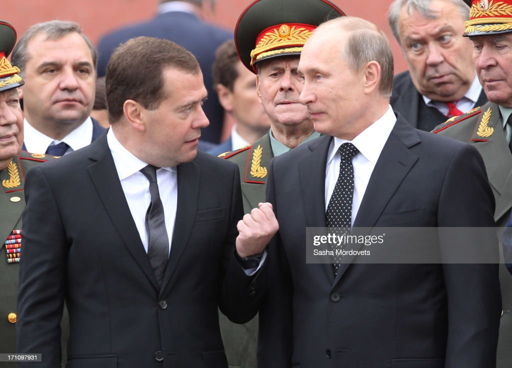 Russian President <a gi-track='captionPersonalityLinkClicked' href=/galleries/search?phrase=Vladimir+Putin&family=editorial&specificpeople=154896 ng-click='$event.stopPropagation()'>Vladimir Putin</a> and Prime Minister <a gi-track='captionPersonalityLinkClicked' href=/galleries/search?phrase=Dmitry+Medvedev&family=editorial&specificpeople=554704 ng-click='$event.stopPropagation()'>Dmitry Medvedev</a> attend a wreath laying ceremony at the Tomb of the Unknown Soldier in Alexander Garden near the Kremlin on June, 22, 2013 in Moscow, Russia. The ceremony marks the 72nd anniversary (June 22nd, 1941) of the Nazi German invasion of the Soviet Union during World War II.