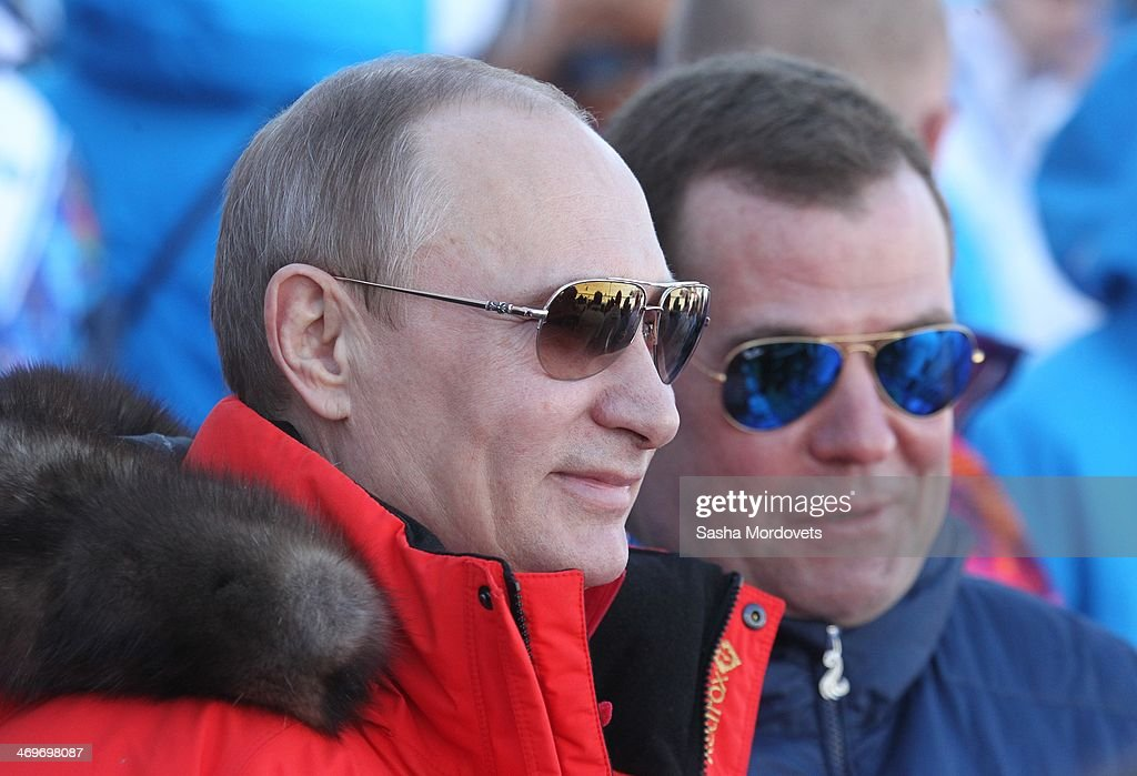Russian President <a gi-track='captionPersonalityLinkClicked' href=/galleries/search?phrase=Vladimir+Putin&family=editorial&specificpeople=154896 ng-click='$event.stopPropagation()'>Vladimir Putin</a> and Prime Minister <a gi-track='captionPersonalityLinkClicked' href=/galleries/search?phrase=Dmitry+Medvedev&family=editorial&specificpeople=554704 ng-click='$event.stopPropagation()'>Dmitry Medvedev</a> (R) watch the men's 4x10 K cross-country relay at the 2014 Winter Olympics, on February 16, 2014 in Krasnaya Polyana, Sochi, Russia. Putin and Medvedev are spending the weekend together in Sochi.