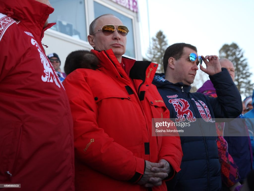 Russian President Vladimir Putin and Prime Minister Dmitry Medvedev (R) watch the men's 4x10 K cross-country relay at the 2014 Winter Olympics, on February 16, 2014 in Krasnaya Polyana, Sochi, Russia. Putin and Medvedev are spending the weekend together in Sochi.