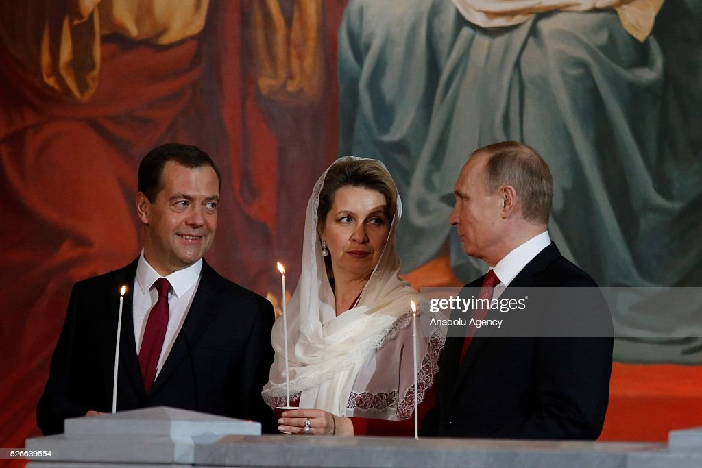 Russian President Vladimir Putin and Prime Minister Dmitry Medvedev attend the Easter service led by Patriarch Kirill of Russia in Christ the Savior Cathedral in Moscow on April 30, 2016.