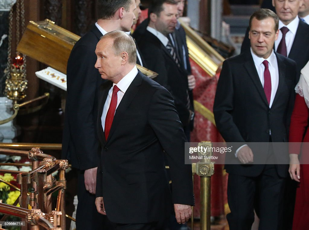 Russian President Vladimir Putin (L) and Prime Minister Dmitry Medvedev (R) arrive to the Orthodox Easter mass at the Christ The Saviour Catherdal, in Moscow, Russia, May,1, 2016. Russian President Vladimir Putin, Moscow Mayor Sergei Sobyanin, Prime Minister Dmitry Medvedev and his wife Svetlana took part an Orthodox Easter service held by Patriarch Kirill at the biggest Russian Orthodox Cathedral.