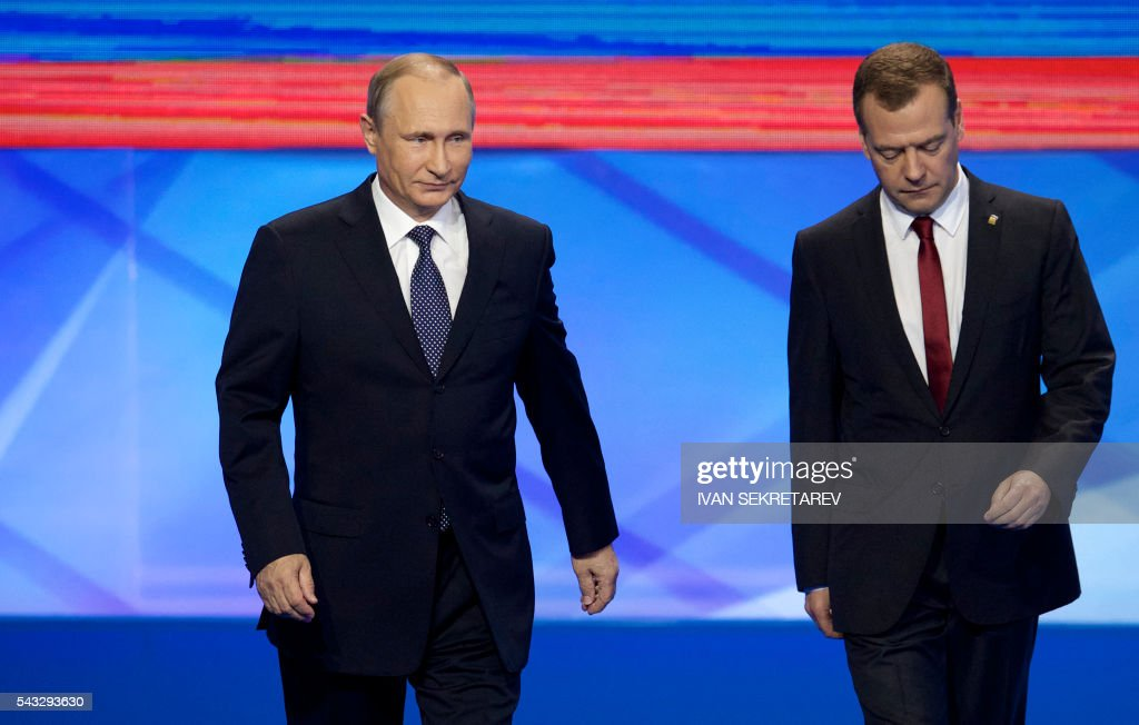 Russian President Vladimir Putin (L) and Prime Minister Dmitry Medvedev arrive for the 15th Convention of the ruling party United Russia in Moscow on June 27, 2016, ahead of parliamentary elections in September. / AFP / POOL / Ivan Sekretarev