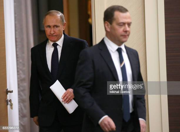 Russian President Vladimir Putin and Prime Minister Dmitry Medvedev enter the hall during his weekly meeting with ministers of the Government on...