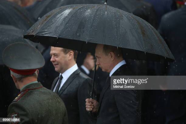 Russian President Vladimir Putin and Prime Minister Dmitry Medvedev attend the wreath laying ceremony to the Unknown Soldier's Tomb at Alexander...
