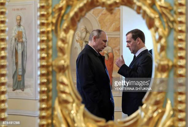 TOPSHOT Russian President Vladimir Putin and Prime Minister Dmitry Medvedev visit the New Jerusalem Orthodox Monastery outside the town of Istra some...