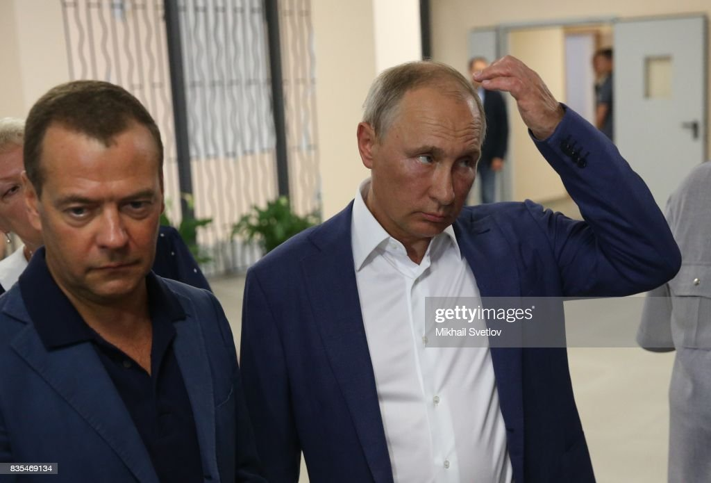 Russian President Vladimir Putin (R) and Prime Minister Dmitry Mevedev (L) observe a newly opened school on August 18, 2017 on Sevastopol, Crimea. Vladimir Putin is in a three day trip to the Black Sea city of Sevastopol, located in Crimean Peninsula, a disputed territory between Ukraine and Russia, annexed in 2014. Photo by Mikhail Svetlov/Getty Images)