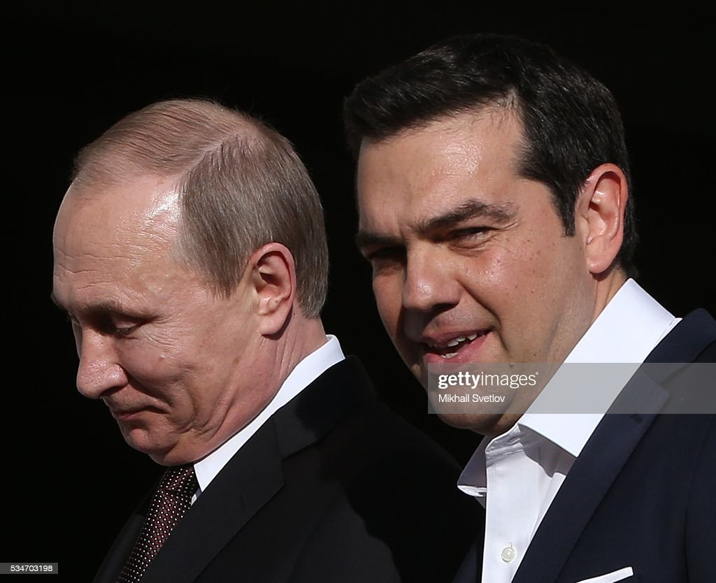 Russian President <a gi-track='captionPersonalityLinkClicked' href=/galleries/search?phrase=Vladimir+Putin&family=editorial&specificpeople=154896 ng-click='$event.stopPropagation()'>Vladimir Putin</a> (L) and Prime Minister of Greece <a gi-track='captionPersonalityLinkClicked' href=/galleries/search?phrase=Alexis+Tsipras&family=editorial&specificpeople=6592450 ng-click='$event.stopPropagation()'>Alexis Tsipras</a> (R) seen during their meeting in Athens, Greece, May 27, 2016. <a gi-track='captionPersonalityLinkClicked' href=/galleries/search?phrase=Vladimir+Putin&family=editorial&specificpeople=154896 ng-click='$event.stopPropagation()'>Vladimir Putin</a> is having a state visit to Greece.