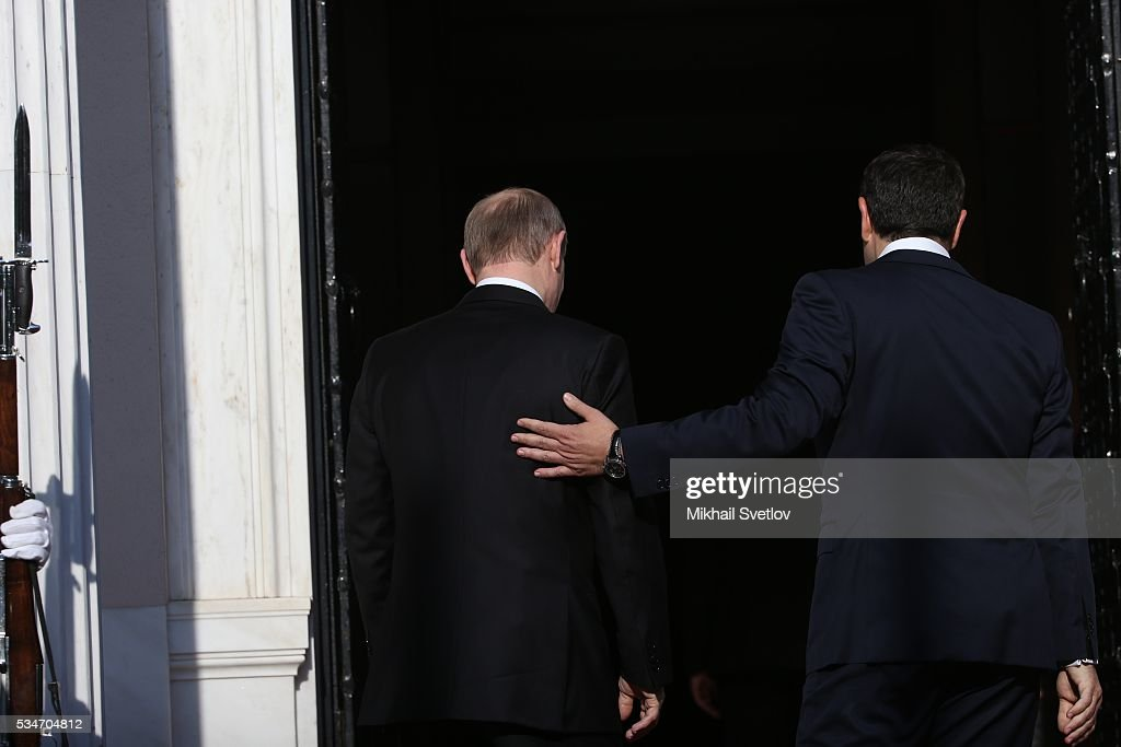 Russian President Vladimir Putin (L) and Prime Minister of Greece Alexis Tsipras (R) seen during their meeting in Athens, Greece, May 27, 2016. Vladimir Putin is having a state visit to Greece.