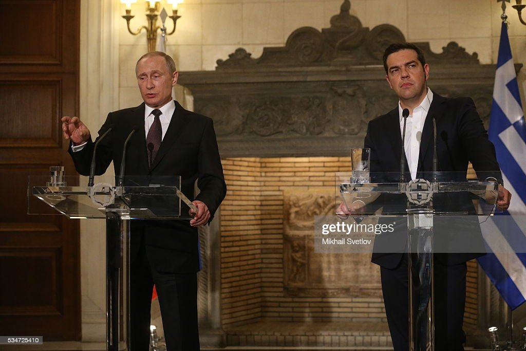 Russian President Vladimir Putin (L) and Prime Minister of Greece Alexis Tsipras (R) attend their joint press conference after the meeting in Athens, Greece, May 27, 2016. Vladimir Putin is having a state visit to Greece.