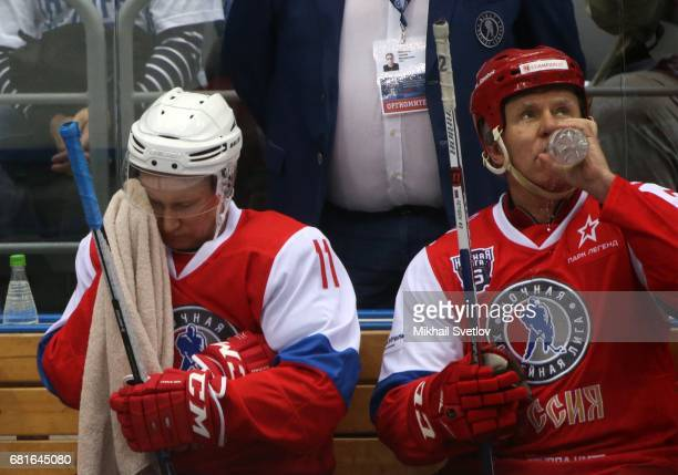 Russian President Vladimir Putin and retired NHL player Slava Fetisov attend a gala match of the Night Hockey League teams at the Bolshoy ice arena...