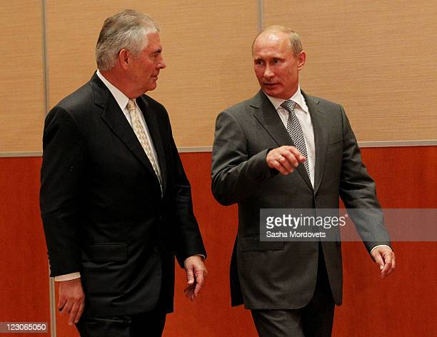 Russian President Vladimir Putin and Rex Tillerson Chairman and CEO of Exxon Mobil during a signing ceremony for an arctic oil exploration deal...