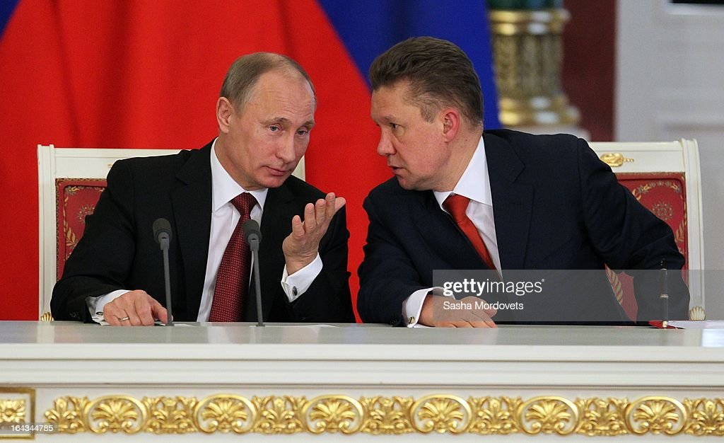 Russian President <a gi-track='captionPersonalityLinkClicked' href=/galleries/search?phrase=Vladimir+Putin&family=editorial&specificpeople=154896 ng-click='$event.stopPropagation()'>Vladimir Putin</a> (L) and RoGazprom's CEO <a gi-track='captionPersonalityLinkClicked' href=/galleries/search?phrase=Alexei+Miller&family=editorial&specificpeople=713081 ng-click='$event.stopPropagation()'>Alexei Miller</a> (R) talk at a meeting with Chinese President Xi Jinping in the Grand Kremlin Palace March 22, 2013 in Moscow, Russia, Xi is making his first foreign visit as China's leader in a move described as demonstrating the two countries' economic interdependence.