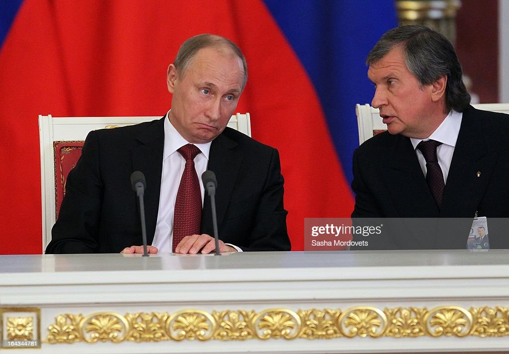 Russian President Vladimir Putin (L) and Rosneft oil company President Igor Sechin (R) attend a meeting with Chinese President Xi Jinping in the Grand Kremlin Palace March 22, 2013 in Moscow, Russia, Xi is making his first foreign visit as China's leader in a move described as demonstrating the two countries' economic interdependence.