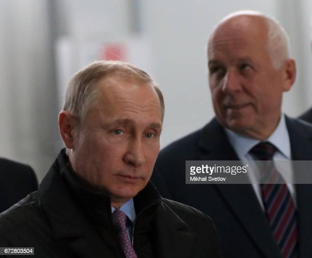 Russian President Vladimir Putin and Rostech CEO Sergei Chemezov arrive to the NPO Saturn in Rybinsk Russia April 2017 Putin is having a oneday trip...