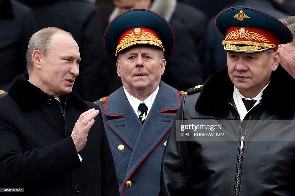 Russian President <a gi-track='captionPersonalityLinkClicked' href=/galleries/search?phrase=Vladimir+Putin&family=editorial&specificpeople=154896 ng-click='$event.stopPropagation()'>Vladimir Putin</a> (L) and Russian Defence Minister Sergei Shoigu (R) react during a wreath laying ceremony at the Tomb of the Unknown Soldier by the Kremlin wall to mark the Defender of the Fatherland Day in Moscow on February 23, 2015. The Defender of the Fatherland Day, celebrated in Russia on February 23, honours the nation's army and is a nationwide holiday.