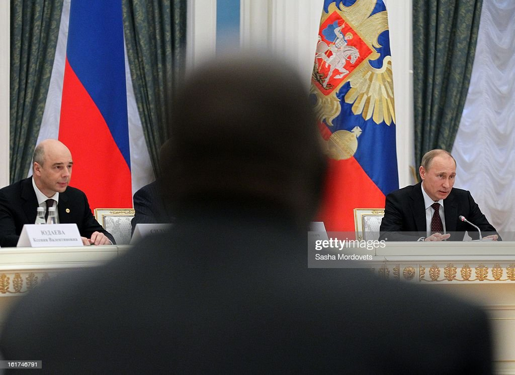 Russian President <a gi-track='captionPersonalityLinkClicked' href=/galleries/search?phrase=Vladimir+Putin&family=editorial&specificpeople=154896 ng-click='$event.stopPropagation()'>Vladimir Putin</a> (R) and Russian Finance Minister Anton Siluanov (L) attend a meeting of the G20 finance leaders in the Kremlin February 15, 2013 in Moscow, Russia. The G20 countries, that make up 90 percent of the worlds gross domestic product, is reportedly set to be dominated by the issue of counties using their currency fro economic gain over the weekend of meetings.
