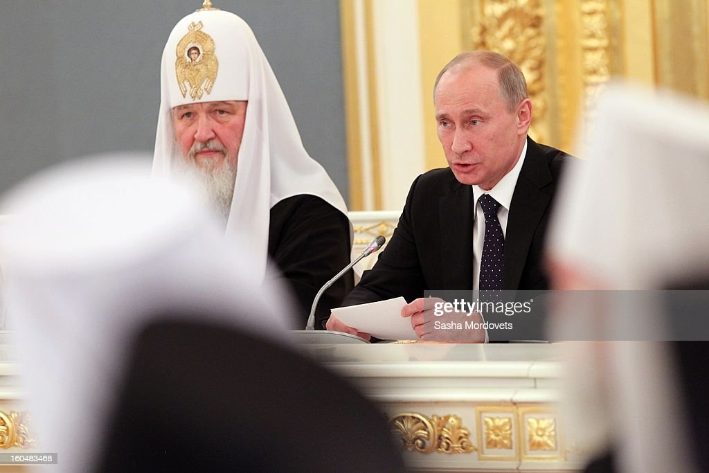Russian President <a gi-track='captionPersonalityLinkClicked' href=/galleries/search?phrase=Vladimir+Putin&family=editorial&specificpeople=154896 ng-click='$event.stopPropagation()'>Vladimir Putin</a> (R) and Russian Orthodox Patriarch Kirill attend a congress of Russian Orthodox Church bishops in the Grand Kremlin Palace February,1,2013 in Moscow, Russia. The congress comes ahead of Putin's visit to Stalingrad tomorrow for a military parade commemorating the battle that proved pivotal in World War II.