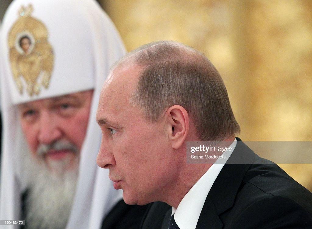 Russian President Vladimir Putin and Russian Orthodox Patriarch Kirill attend a congress of Russian Orthodox Church bishops in the Grand Kremlin...