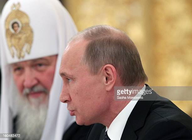 Russian President Vladimir Putin and Russian Orthodox Patriarch Kirill attend a congress of Russian Orthodox Church bishops in the Grand Kremlin...