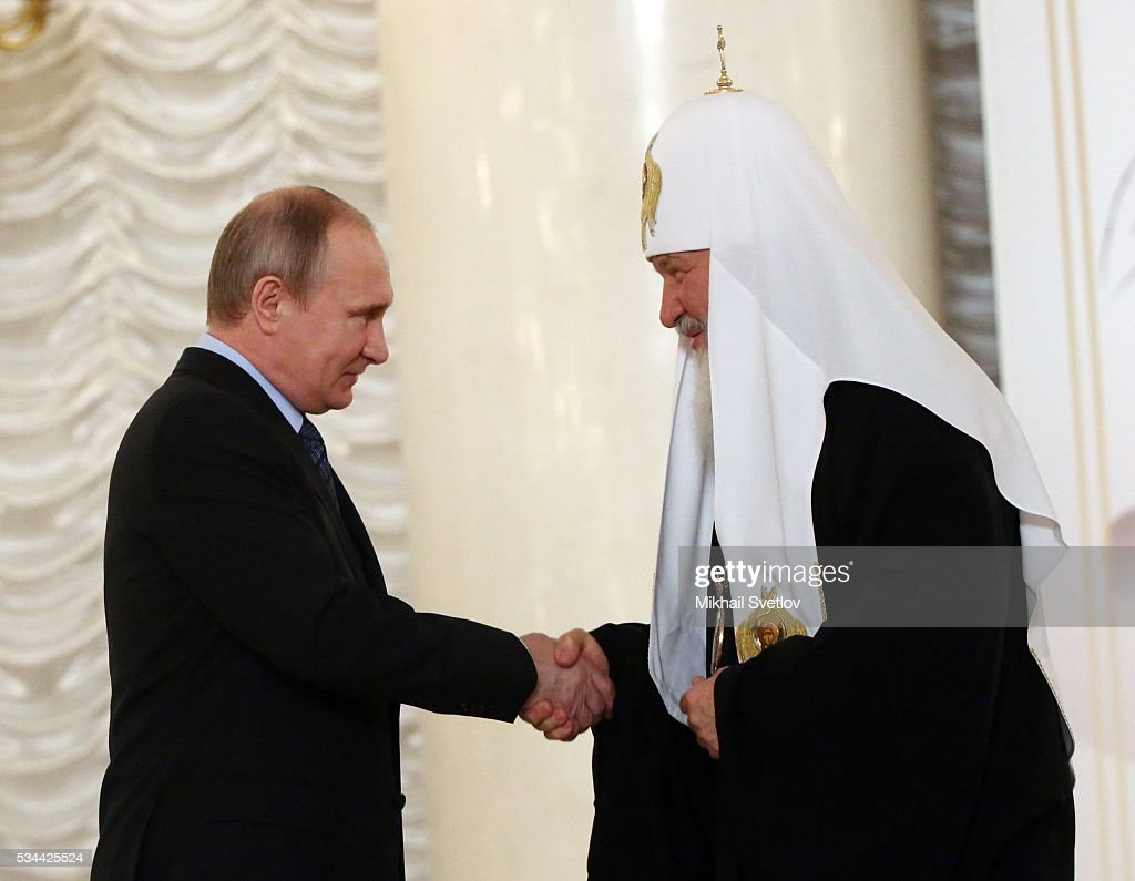 Russian President <a gi-track='captionPersonalityLinkClicked' href=/galleries/search?phrase=Vladimir+Putin&family=editorial&specificpeople=154896 ng-click='$event.stopPropagation()'>Vladimir Putin</a> and Russian Orthodox Patriarch Kirill attend the Congress of Russian Literature and Society on May 26, 2016 in Moscow, Russia.