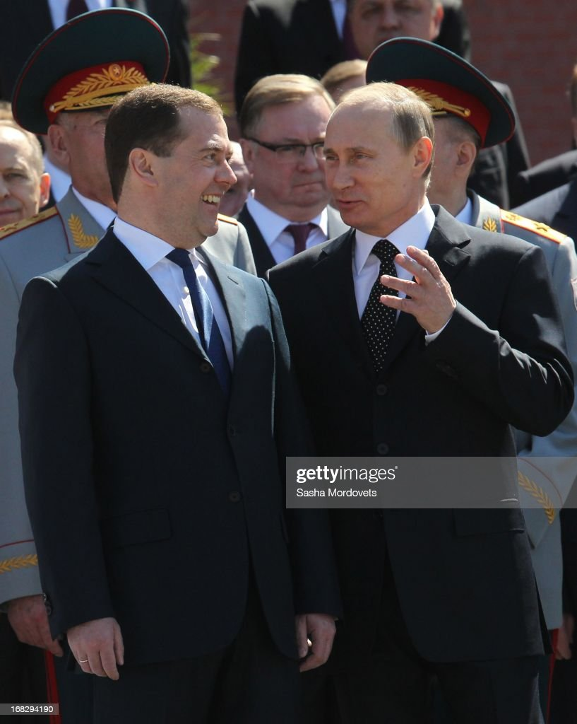 Russian President Vladimir Putin (R) and Russian Prime Minister Dmitry Medvedev attend a wreath laying ceremony at the Tomb of the Unknown Soldier near the Kremlin on May,8 2013 in Moscow, Russia. Russia will tomorrow hold traditional parades to mark the 68th anniversary of the defeat of Nazi Germany in World War II .
