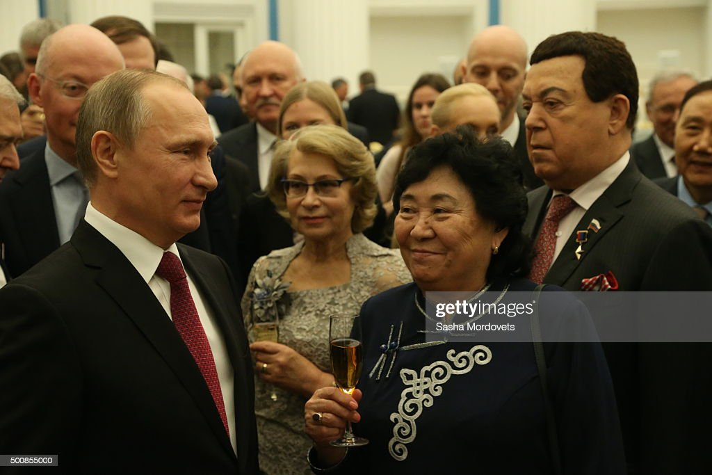 Russian President <a gi-track='captionPersonalityLinkClicked' href=/galleries/search?phrase=Vladimir+Putin&family=editorial&specificpeople=154896 ng-click='$event.stopPropagation()'>Vladimir Putin</a> (L) and singer Joseph Kobzon (R) seen during awarding ceremony at the Kremlin on December 10, 2015 in Moscow, Russia. Putin awarded four dozens people, including actors, scientists, businessmen and workers, during the ceremony on Thursday.