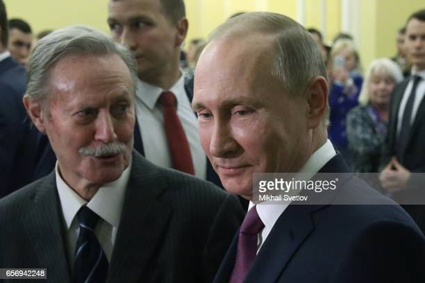 Russian President Vladimir Putin and theatre director Yuri Solomin observe the interior of the Maly Theatre during a visit to watch the comedy 'The...
