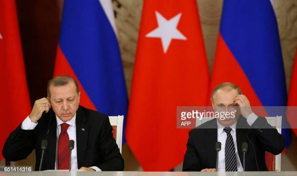 TOPSHOT Russian President Vladimir Putin and Turkey's President Recep Tayyip Erdogan attend a news conference after their talks at the Kremlin in...
