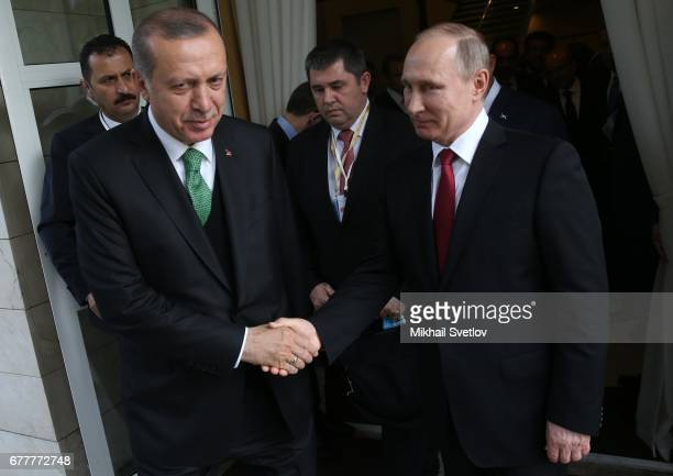 Russian President Vladimir Putin and Turkish President Recep Tayyip Erdogan are seen during their meeting at Bocharov ruchey state residence at Black...