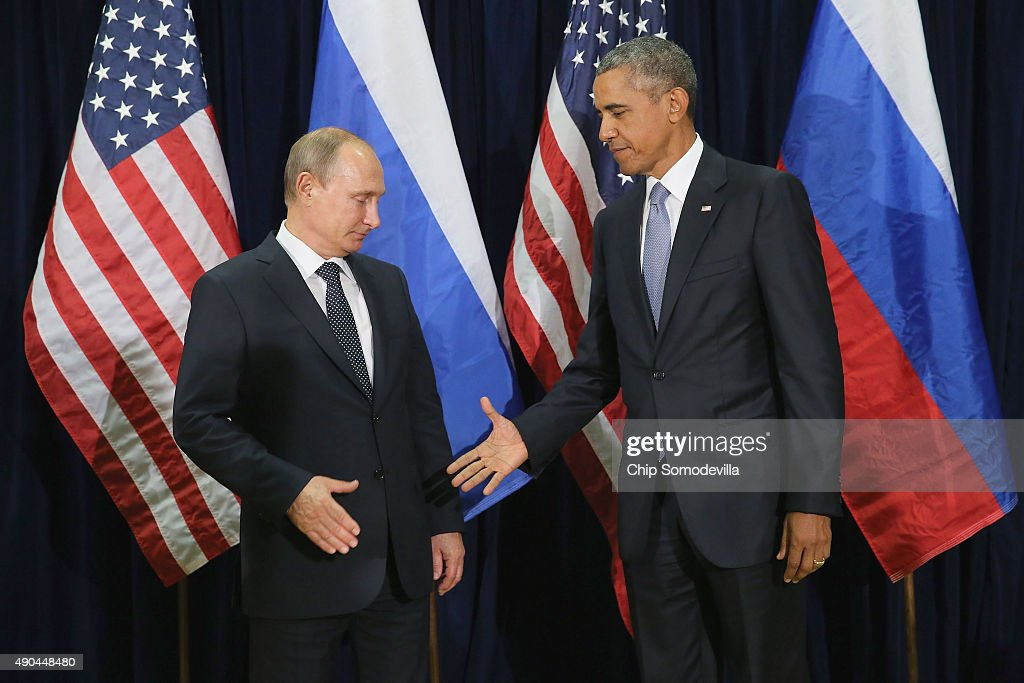 Russian President <a gi-track='captionPersonalityLinkClicked' href=/galleries/search?phrase=Vladimir+Putin&family=editorial&specificpeople=154896 ng-click='$event.stopPropagation()'>Vladimir Putin</a> (L) and U.S. President <a gi-track='captionPersonalityLinkClicked' href=/galleries/search?phrase=Barack+Obama&family=editorial&specificpeople=203260 ng-click='$event.stopPropagation()'>Barack Obama</a> shake hands for the cameras before the start of a bilateral meeting at the United Nations headquarters September 28, 2015 in New York City. Putin and Obama are in New York City to attend the 70th anniversary general assembly meetings.