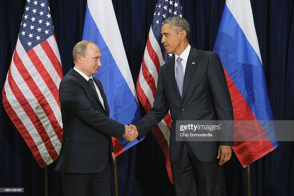 Russian President Vladimir Putin (L) and U.S. President <a gi-track='captionPersonalityLinkClicked' href=/galleries/search?phrase=Barack+Obama&family=editorial&specificpeople=203260 ng-click='$event.stopPropagation()'>Barack Obama</a> shake hands for the cameras before the start of a bilateral meeting at the United Nations headquarters September 28, 2015 in New York City. Putin and Obama are in New York City to attend the 70th anniversary general assembly meetings.