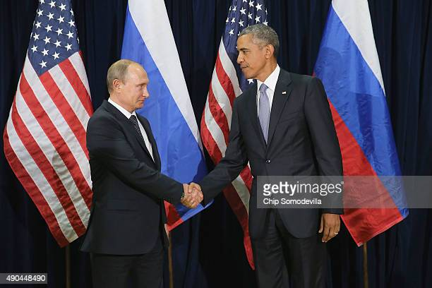 Russian President Vladimir Putin and US President Barack Obama shake hands for the cameras before the start of a bilateral meeting at the United...