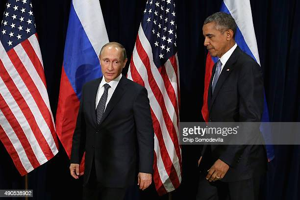 Russian President Vladimir Putin and US President Barack Obama walk out for a photoop before the start of a bilateral meeting at the United Nations...