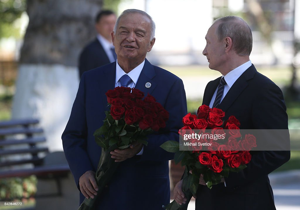 Russian President <a gi-track='captionPersonalityLinkClicked' href=/galleries/search?phrase=Vladimir+Putin&family=editorial&specificpeople=154896 ng-click='$event.stopPropagation()'>Vladimir Putin</a> (R) and Uzbek President <a gi-track='captionPersonalityLinkClicked' href=/galleries/search?phrase=Islam+Karimov&family=editorial&specificpeople=563286 ng-click='$event.stopPropagation()'>Islam Karimov</a> (L) as they put flowers to the monument of Russian poet Alexander Pushkin during the Shanghai Cooperation Organisation (SCO) Summit in Tashkent, Uzbekistan, June, 24, 2016. Leaders of China, India and Russia have arrived to Uzbekistan to attend the Shanghai Cooperation Organisation (SCO) Summit.