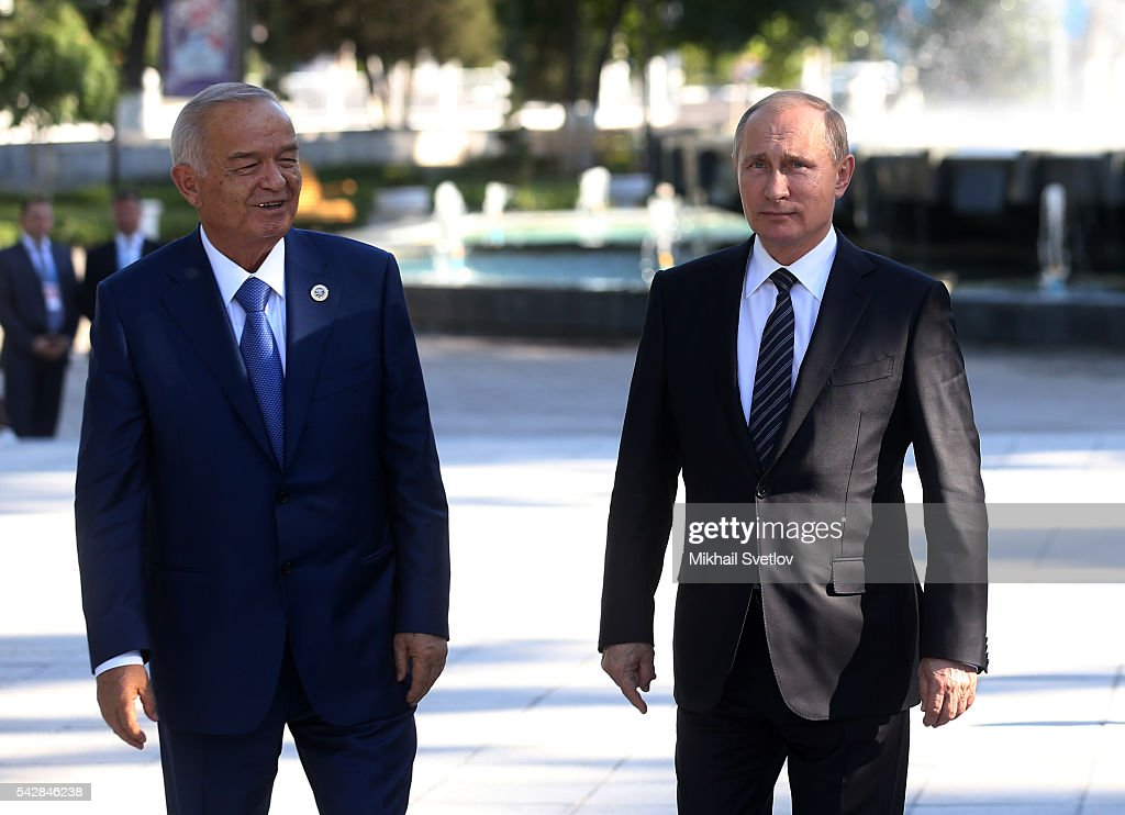 Russian President <a gi-track='captionPersonalityLinkClicked' href=/galleries/search?phrase=Vladimir+Putin&family=editorial&specificpeople=154896 ng-click='$event.stopPropagation()'>Vladimir Putin</a> (R) and Uzbek President <a gi-track='captionPersonalityLinkClicked' href=/galleries/search?phrase=Islam+Karimov&family=editorial&specificpeople=563286 ng-click='$event.stopPropagation()'>Islam Karimov</a> walk during the Shanghai Cooperation Organisation (SCO) Summit in Tashkent, Uzbekistan, June, 24, 2016. Leaders of China, India and Russia have arrived to Uzbekistan to attend the Shanghai Cooperation Organisation (SCO) Summit.