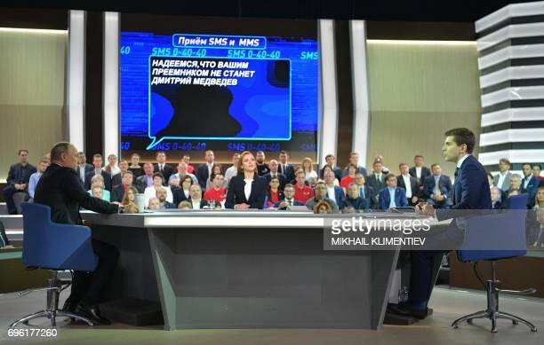 Russian President Vladimir Putin answers questions at the Gostiny Dvor studio during the annual 'Direct Line with Vladimir Putin broadcast live' by...