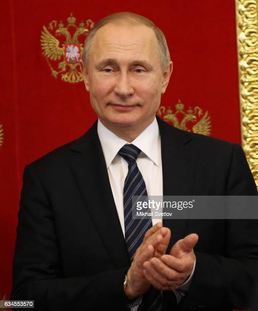 Russian President Vladimir Putin applauds during his joint press conference with Slovenian President Borut Pahor at the Kremlin in Moscow Russia...