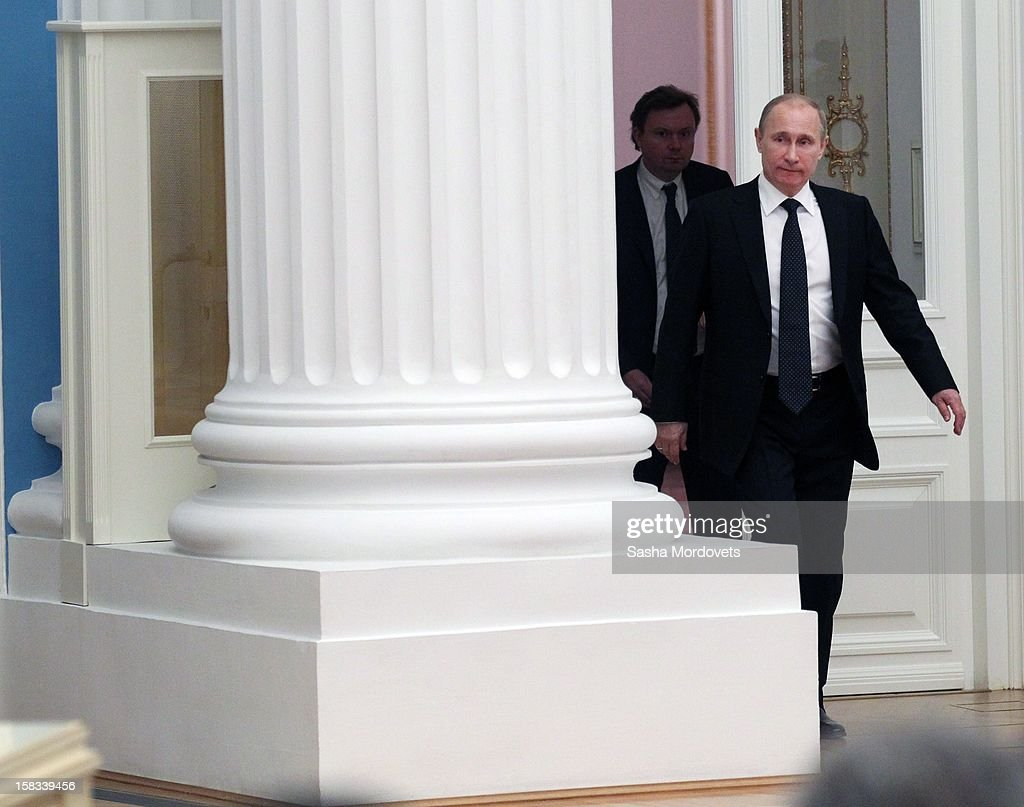 Russian President <a gi-track='captionPersonalityLinkClicked' href=/galleries/search?phrase=Vladimir+Putin&family=editorial&specificpeople=154896 ng-click='$event.stopPropagation()'>Vladimir Putin</a> arrives a meeting of lawmakers in the Kremlin December 13, 2012 in Moscow, Russia. Putin has described as 'unfriendly' a U.S. bill that imposes sanctions on Russian officials accused of human rights violations.