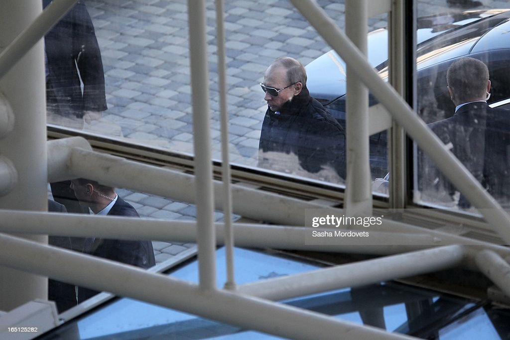 Russian President <a gi-track='captionPersonalityLinkClicked' href=/galleries/search?phrase=Vladimir+Putin&family=editorial&specificpeople=154896 ng-click='$event.stopPropagation()'>Vladimir Putin</a> arrives at the Bolshoy Ice Dome, an ice hockey arena, in the Sochi Olympic Park on March, 2013 in Russia.