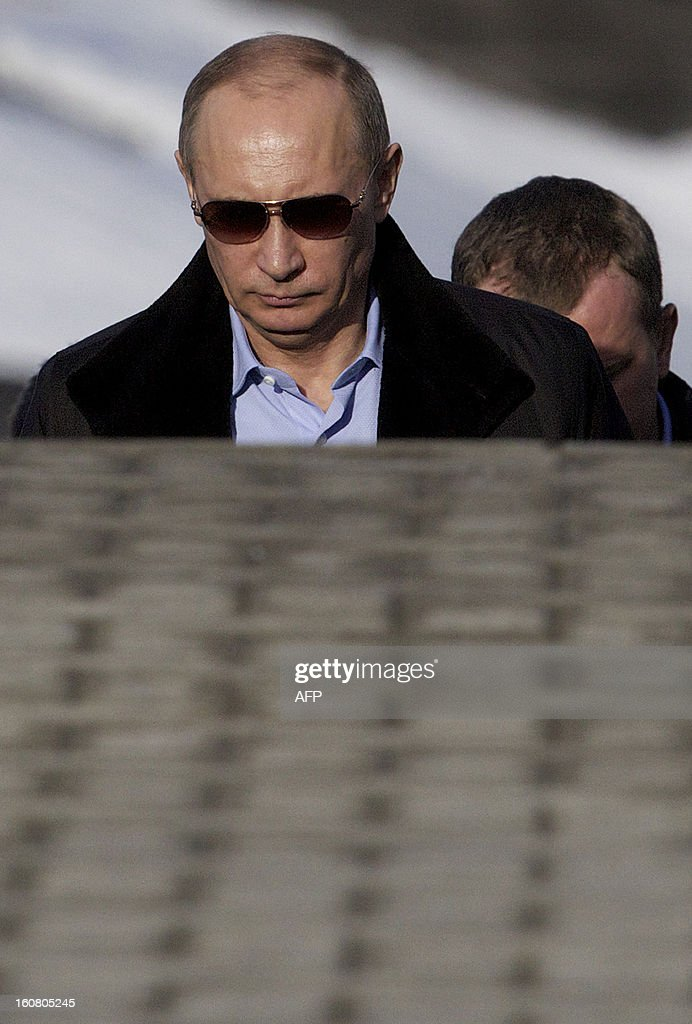 Russian President Vladimir Putin arrives at the Rosa Khutor Alpine Centre, one of the Sochi 2014 Winter Olympic venues, near the Black Sea city of Sochi, on February 6, 2013. AFP PHOTO / POOL/ IVAN SEKRETAREV