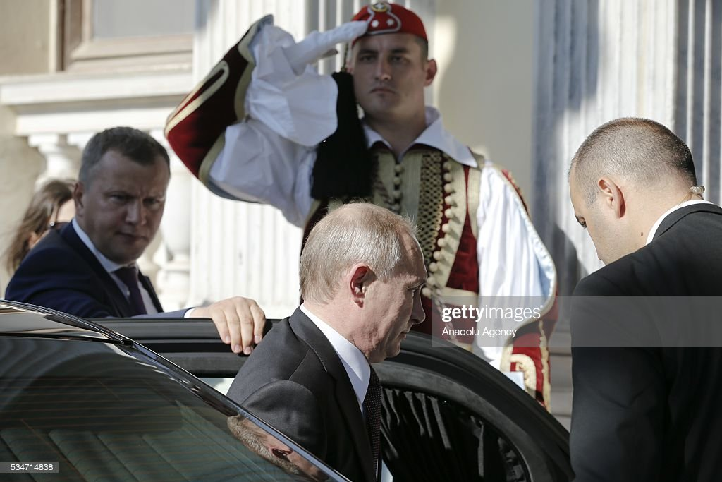 Russian President Vladimir Putin (C) arrives for a meeting with Greek President Prokopis Pavlopoulos (not seen) in Athens, Greece on May 27, 2016.