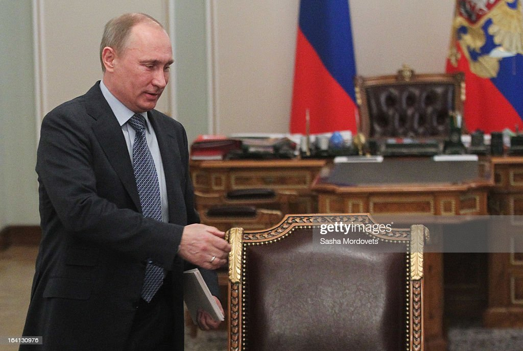 Russian President <a gi-track='captionPersonalityLinkClicked' href=/galleries/search?phrase=Vladimir+Putin&family=editorial&specificpeople=154896 ng-click='$event.stopPropagation()'>Vladimir Putin</a> arrives for a meeting with ministers and delegates from energy companies on March 20, 2013 in Moscow, Russia. Putin is due to meet China's new leader Xi Jinping later this week and 'key issues of bilateral cooperation' including energy, investments and the ongoing conflict in Syria are on the agenda for discussion.